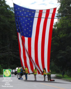 ba15_0141bethelfirefightersholdflag